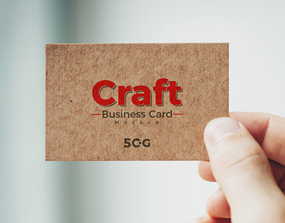 Free Man Holding Craft Business Card Mockup PSD 2018