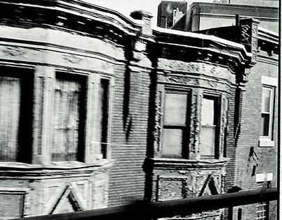 Philadelphia-- The El train and city buildings.