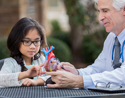 Doctor Talking to a Little Girl