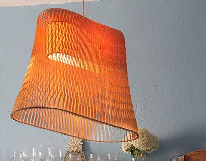 Hand made wooden lamp by studio inbetween