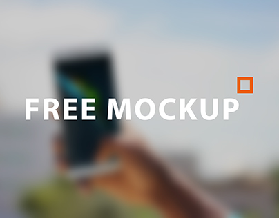 FREE MOCKUP Black African Man Holding a Smartphone