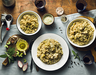 Classic Italian risotto with mushrooms on a wooden