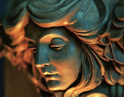 Sculpture of lady's face, within a Art Nouveau capital.