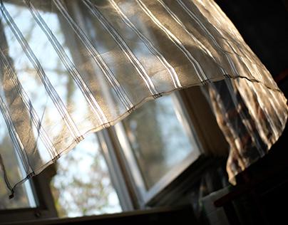 Golden light on the curtain