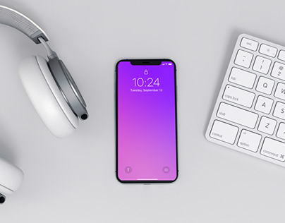 Modern iPhone x Mockup on a Workspace