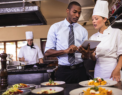 Male Manager and Female chef Check Food Quality