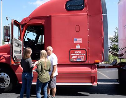Status Transportation Staff helping Owner Operator