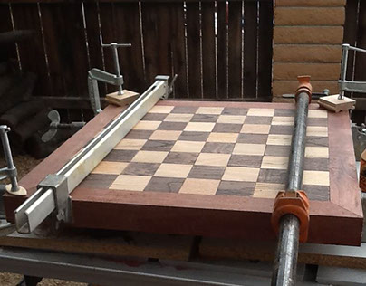 Chess board with oak floorboards and purple heart