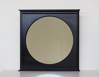 Black wooden mirror