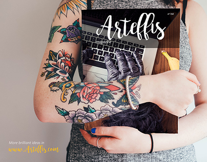 Free Magazine Mockup held by a tattooed woman
