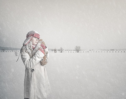 Young girl in a snow-covered field.