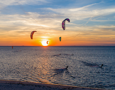 Kite surfing on Mobile Bay at sunset