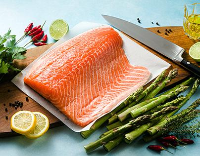 Fresh salmon slice on a wooden cutting board