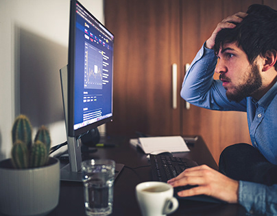 Shocked Businessman Working at Home
