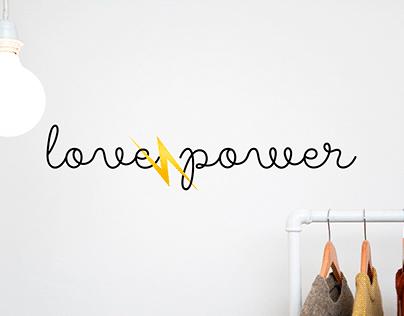 Logo for the brand of women's clothing Love & Power