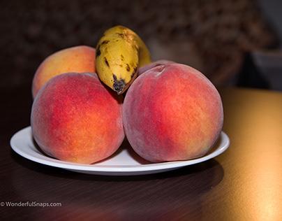 Peaches and banana, still life