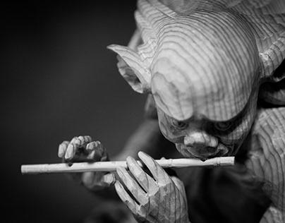 Goblin blowing a flute (横笛を吹く悪魔)