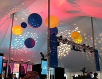 Big 5Ft. balloons inside of a tent for corporate decor