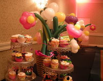 Flower balloons with cupcakes for Bat Mitzvah decor