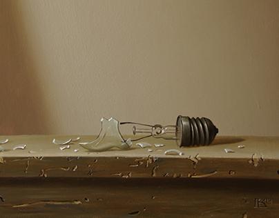 Still-life with  broken light bulb