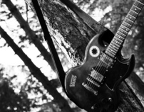 Play the guitar in the forest.