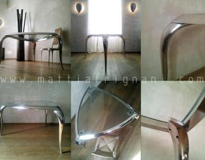 Table in casted polished aluminium and crystal